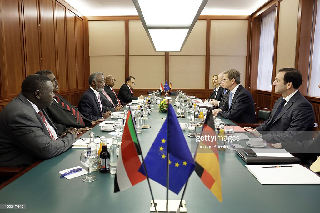 German Foreign Minister Guido Westerwelle (2R) and Sudanese Foreign Minister Ali Karti (3L) meet at the Federal Foreign Office on January 29, 2013 in Berlin, Germany. Their talks will focus on the peace process between Sudan and South Sudan.