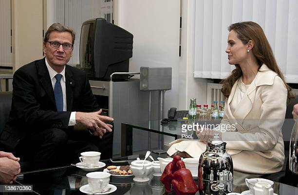 German Foreign Minister Guido Westerwelle and UNHCR Goodwill Ambassador Angelina Jolie chat before a meeting at the Federal Foreign Office on...