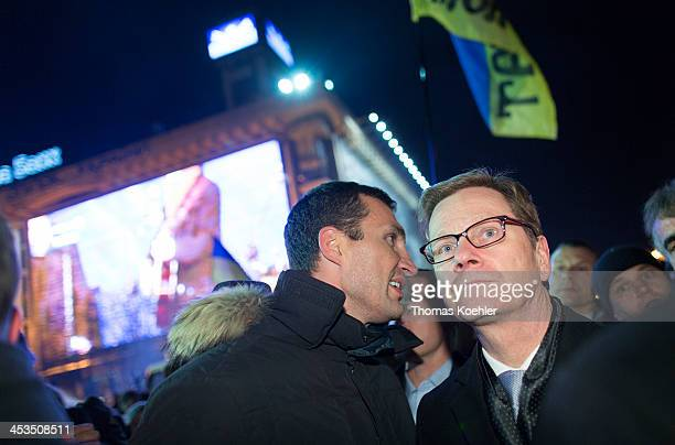 German Foreign Minister Guido Westerwelle and Vitali Klitschko leader of Ukraine's UDAR opposition party walk towards the Maidan square to visit the...