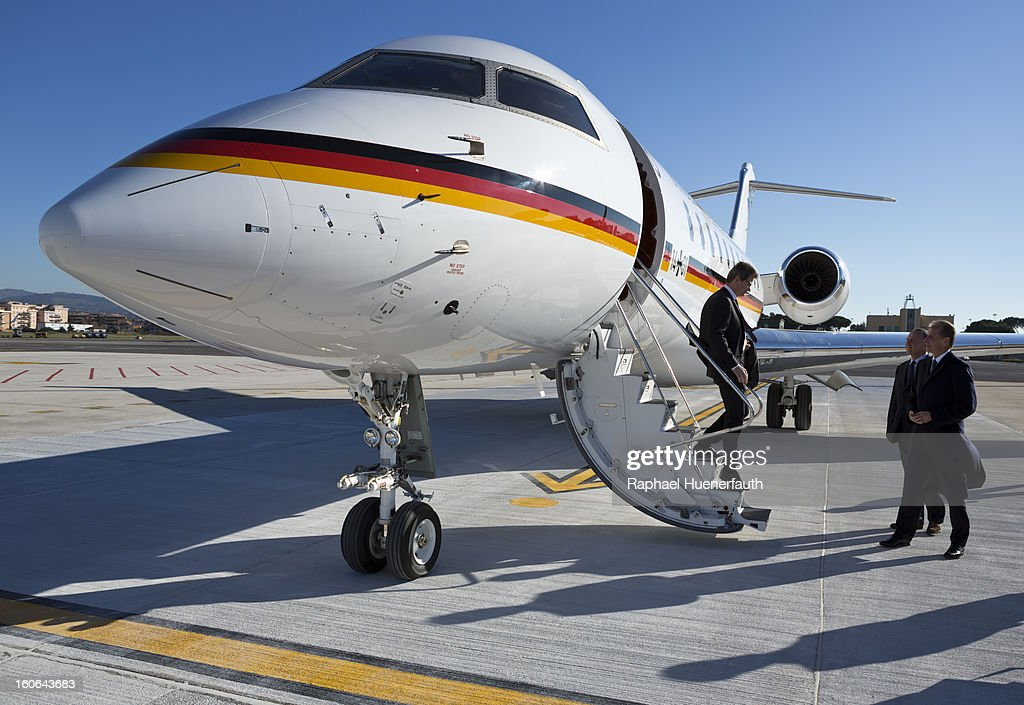 German Foreign Minister Guido Westerwelle (L) as he disembarks a Global 5000 airplane, part of the Special Air Mission Wing Fleet MoD (Ministry of Defense) at Rome's Ciampino Airport and is greeted by the ambassador Reinhard Schaefers (R) on December 19, 2012 in Rome, Italy. Photo by Raphael Huenerfauth/Photothek via Getty Images)