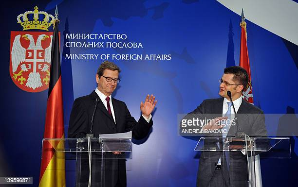 German Foreign Minister Guido Westerwelle gestures during a joint press conference with his Serbian counterpart Vuk Jeremic after their meeting in...