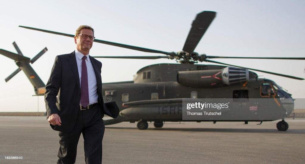 German Foreign Minister Guido Westerwelle leave a CH-53 Helicopter after his arrival from Kunduz on October 06, 2013 in Mazar-i Sharif, Afghansitan. Westerwelle visit Afghanistan to hand over German PRT in Kunduz to the Afghan Military.