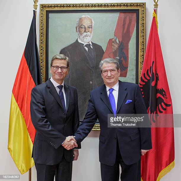 German Foreign Minister Guido Westerwelle shakes hands after a meeting with Albanian Prime Minister Sali Berisha on February 22 2013 in Tirana...