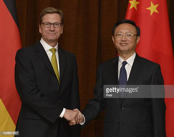 German Foreign Minister Guido Westerwelle shakes hands with Chinese Foreign Minister Yang Jiechi ahead of their meeting on October 11, 2012 in...