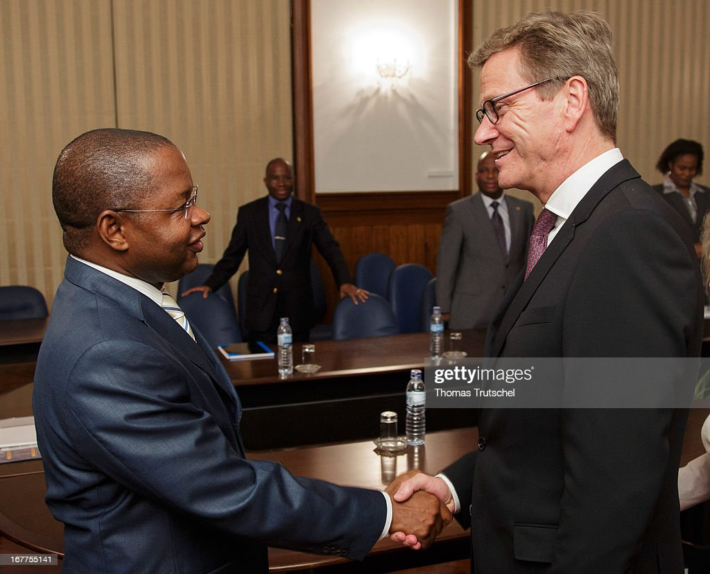 German Foreign Minister Guido Westerwelle (R) shakes hands with Prime Minister of Mozambique, Alberto Vaquina on April 30, 2013 in Maputo, Mozambique. Westerwelle is on a four day trip to Africa with stops in Ghana, South Africa and Mozambique.