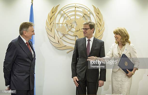 German Foreign Minister Guido Westerwelle signs the ATT Arms Trade Treaty in presence of Patricia O'Brian United Nations UnderSecretaryGeneral for...