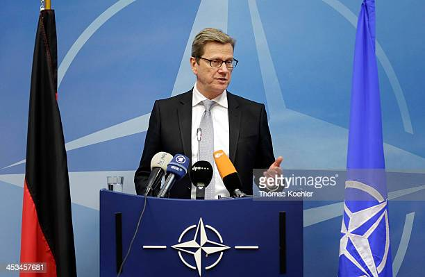 German Foreign Minister Guido Westerwelle talks during a press conference on the day of a meeting of NATO Foreign Ministers with nonNATO ISAF troop...