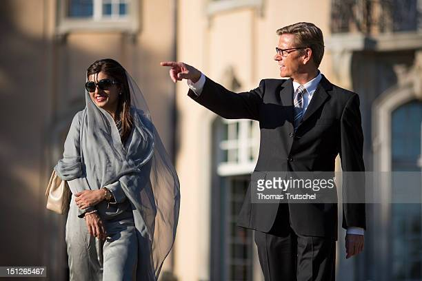 German Foreign Minister Guido Westerwelle talks with Pakistan Foreign Minister Hina Rabbani Khar in the garden of the Villa Borsig in Berlin on...