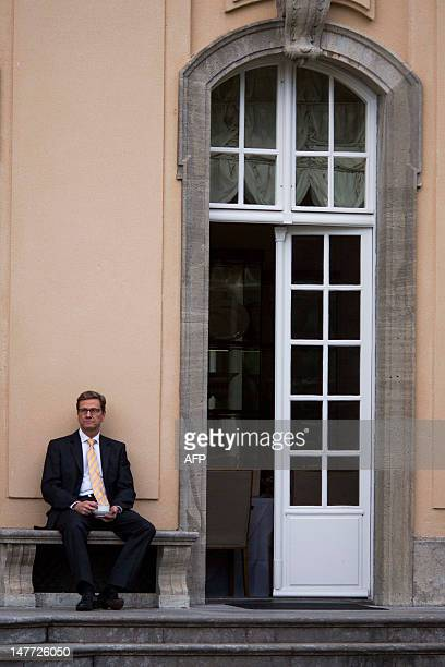 German Foreign Minister Guido Westerwelle waits for his Spanish counterpart outside the Villa Borsig in Berlin on July 2, 2012. AFP PHOTO / CARSTEN...