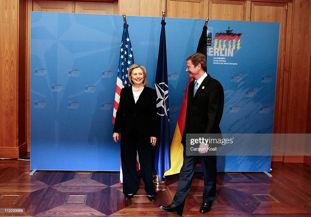German Foreign Minister Guido Westerwelle (R) welcomes U.S. Secretary of State Hillary Clinton for bilateral talk to an informal meeting of NATO member foreign ministers on April 15, 2011 in Berlin, Germany. The principal focus of the two-day meeting is the alliance's military involvement in the war in Libya, though it also includes special roundtables on the alliance's relationship to Russia, Ukraine and Georgia.