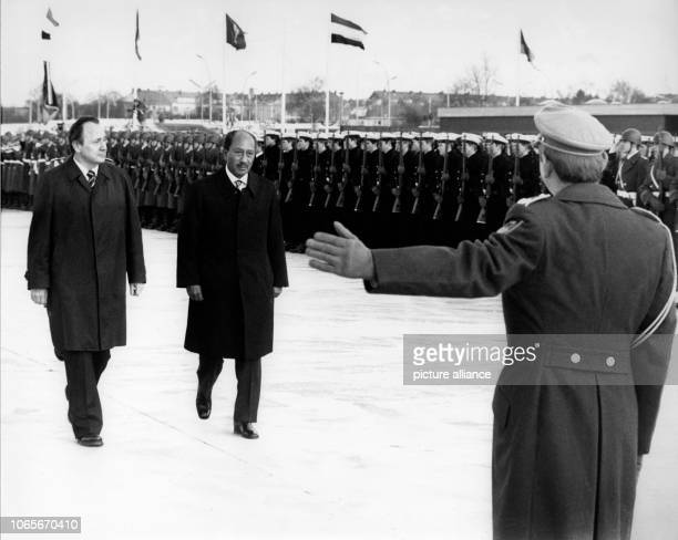 German Foreign Minister HansDietrich Genscher welcomes Egyptian President Anwar ElSadat with military honors at Fuhlsbüttel Airport in Hamburg 9...