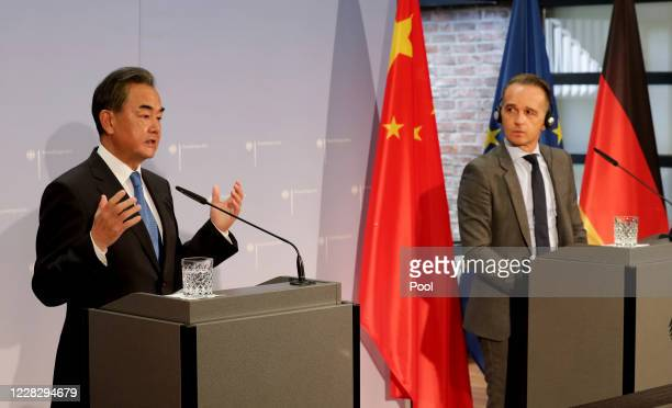 German Foreign Minister Heiko Maas and China's Foreign Minister Wang Yi address the media during a joint press conference as part of a meeting on...