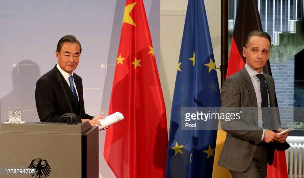 German Foreign Minister Heiko Maas and China's Foreign Minister Wang Yi leave after a joint press conference as part of a meeting on September 01...