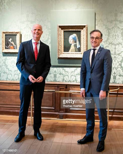 German Foreign Minister Heiko Maas and Foreign Minister of Netherlands Stef Blok pose for a photo as they visit the museum Mauritshuis on June 04...