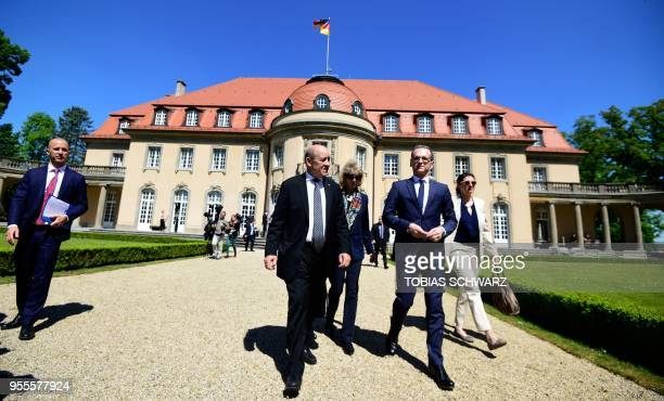 German Foreign Minister Heiko Maas and his French counterpart JeanYves Le Drian take a walk outside the German Foreign Ministry's Villa Borsig...