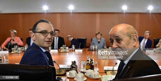 German Foreign Minister Heiko Maas and his French counterpart JeanYves Le Drian have taken seat to attend the weekly meeting of the German cabinet in...