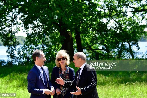 German Foreign Minister Heiko Maas and his French counterpart JeanYves Le Drian talk as they take a walk outside the German Foreign Ministry's Villa...
