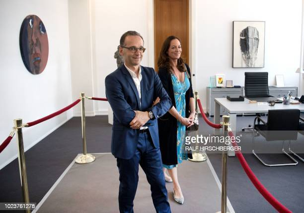 German Foreign Minister Heiko Maas and his partner German actress Natalia Woerner pose at Maas' office at the Foreign Ministry in Berlin during an...