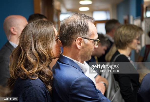 German Foreign Minister Heiko Maas and his partner German actress Natalia Woerner along with visitors inspect the Foreign Office's Crisis Response...