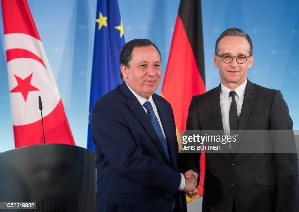 German Foreign Minister Heiko Maas and his Tunisian counterpart Khemaies Jhinaoui shake hands after a joint press conference following talks at the...