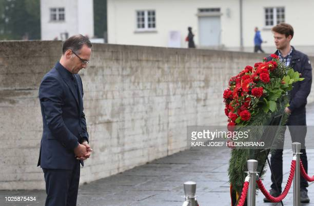 German Foreign Minister Heiko Maas commemorates victims of the Nazi regime during World War II in front of a wreath at the memorial of the former...