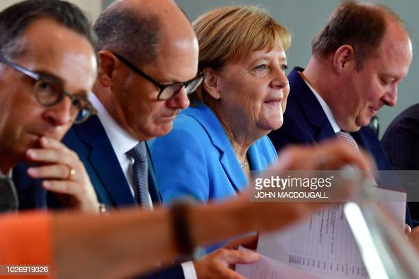 German Foreign Minister Heiko Maas German Finance Minister and ViceChancellor Olaf Scholz and German Chief of Staff Helge Braun sit prior to the...