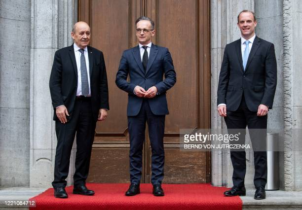 German Foreign Minister Heiko Maas , his French counterpart Jean-Yves Le Drian and Britain's Secretary of State Dominic Raab pose before talks at...