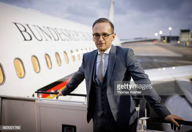 German Foreign Minister Heiko Maas poses for the photographer in front of the airplane which is going to bring him to Paris on March 14 2018 in...