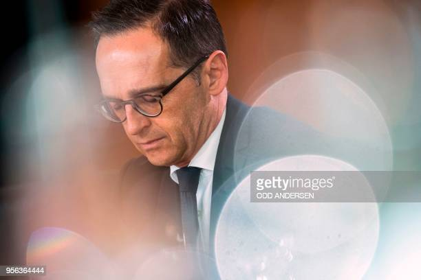 German Foreign Minister Heiko Maas reads a brief at the weekly cabinet meeting at the Chancellery in Berlin on May 9 2018