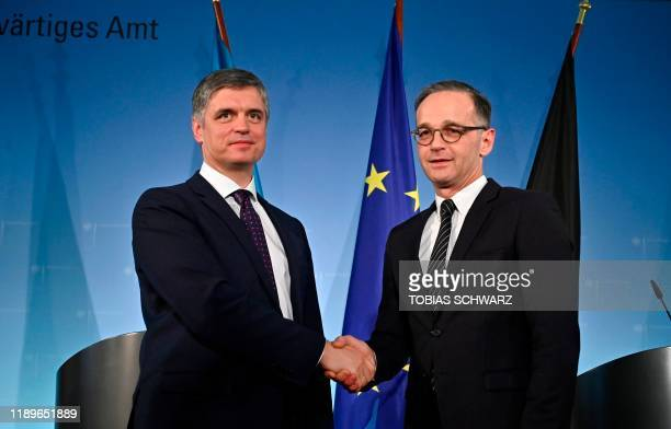 German Foreign Minister Heiko Maas shakes hands with his Ukrainian counterpart Vadym Prystaiko at the end of a joint press conference in Berlin on...