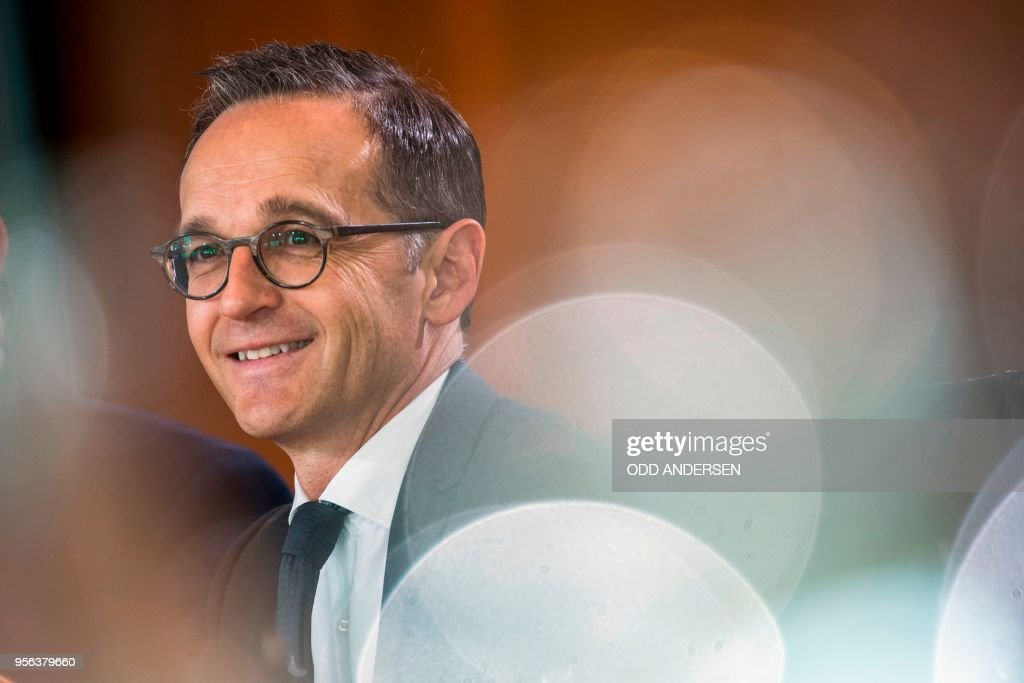 German Foreign Minister Heiko Maas smiles during the weekly cabinet meeting at the Chancellery in Berlin on May 9, 2018.