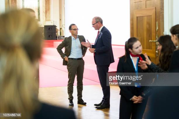 German Foreign Minister Heiko Maas talks with Simon Conveney Foreign Minister of Ireland during the Gymnich Meeting on August 31 2018 in Vienna...