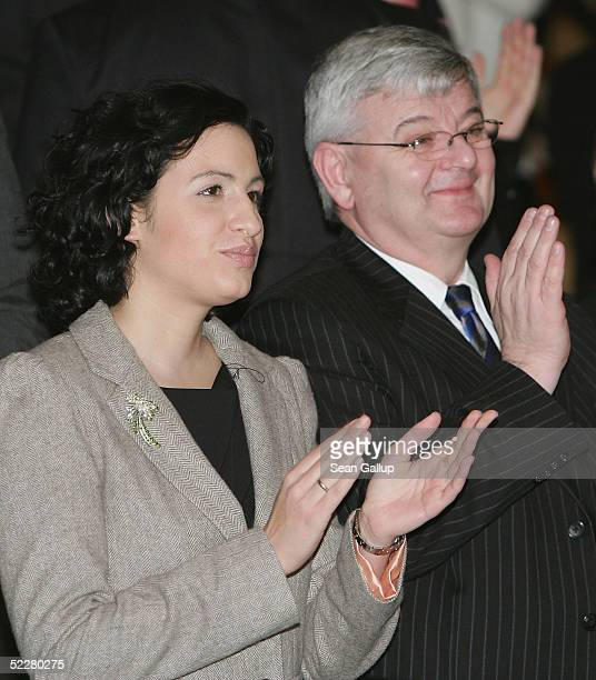 German Foreign Minister Joschka Fischer and his girlfriend Minu Barati applaud at the conclusion of a Tsunami Benefit Concert at the Berlin...