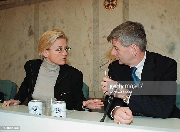 German Foreign Minister Joschka Fischer listens to his Swedish counterpart Anna Lindh during their joint press conference at the government's...