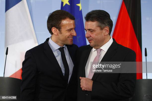 German Foreign Minister Sigmar Gabriel and French presidential candidate Emmanuel Macron pose after they gave a statements to the media at the...