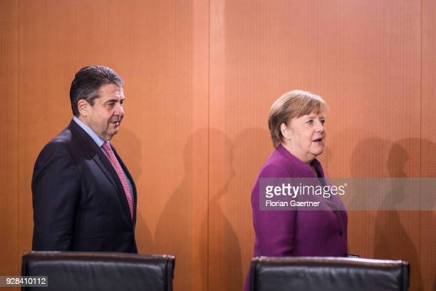 German Foreign Minister Sigmar Gabriel and German Chancellor Angela Merkel arrive at the weekly interim government cabinet meeting on March 07 2018...