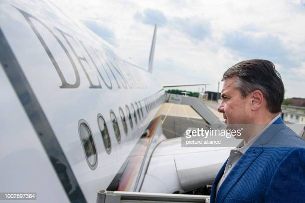 German Foreign Minister Sigmar Gabriel boards a Luftwaffe Airbus A340 in the military sector of Tegel Airport in Berlin Germany 23 May 2017 Minister...