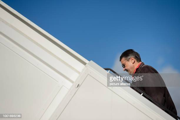 German foreign minister Sigmar Gabriel boards an Airbus A340 of the German Air Force at the military part of Tegel Airport in Berlin Germany 3 July...