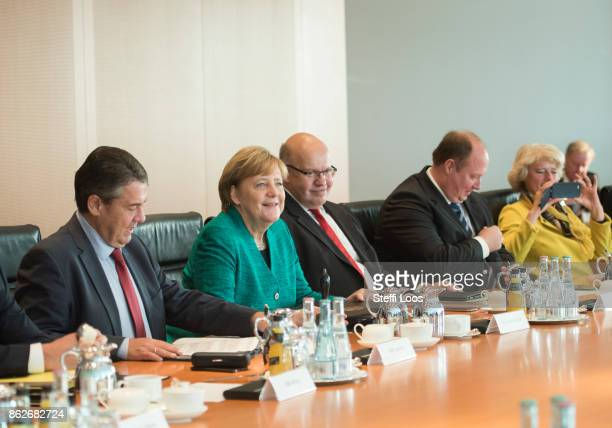 German Foreign Minister Sigmar Gabriel Chancellor Angela Merkel and Head of the Federal Chancellery Peter Altmaier attend the weekly cabinet meeting...
