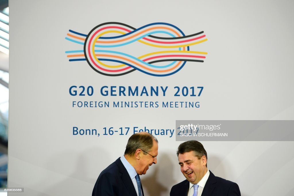 German Foreign Minister Sigmar Gabriel (R) greets Russian Foreign Minister Sergei Lavrov upon his arrival at the World Conference Center in Bonn, western Germany, on February 16, 2017, the venue of a G20 Foreign Ministers Meeting that will take place until February 17, 2017. US Secretary of State Rex Tillerson will make his diplomatic debut at the G20 gathering, where his counterparts hope to find out what 'America First' means for the rest of the world. / AFP / Sascha Schuermann