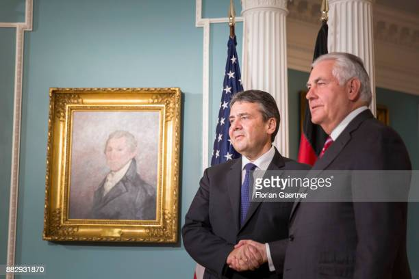 German Foreign Minister Sigmar Gabriel shakes hands with Secretary of State Rex Tillerson on November 30 2017 in Washington DC According to reports...