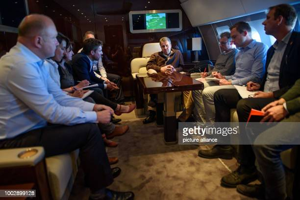 German Foreign Minister Sigmar Gabriel sits together with journalists during a backgrounder speech in a conference room of a Luftwaffe A340 Airbus...
