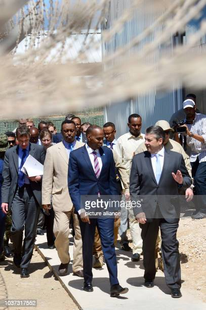 German Foreign Minister Sigmar Gabriel speaking to Prime Minister Hassan Ali Khaire as they go through the international security zone at the airport...