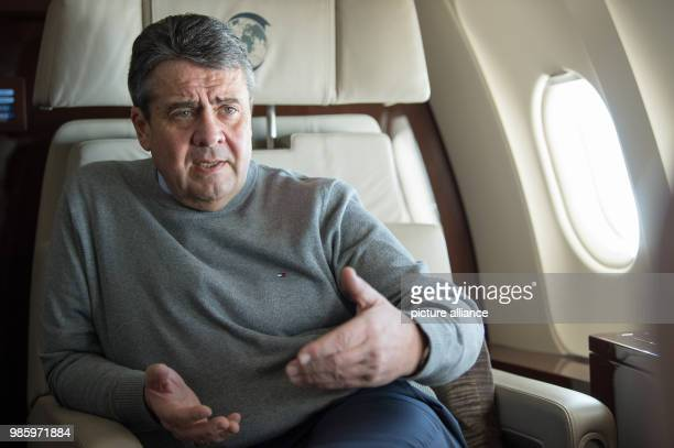 German Foreign Minister Sigmar Gabriel speaking to the press aboard a German Air Force Airbus A319 in Berlin Germany 14 February 2018 Gabriel is...