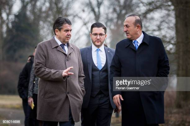 German Foreign Minister Sigmar Gabriel walks through the garden of Villa Borsig with Mevluet Cavusoglu Foreign Minister of Turkey and his consultant...