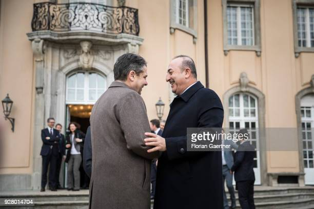 German Foreign Minister Sigmar Gabriel walks through the garden of Villa Borsig with Mevluet Cavusoglu Foreign Minister of Turkey on March 06 2018 in...
