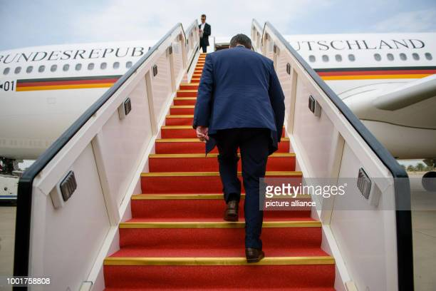 German Foreign Minister walks up to an Airbus A340 of the Special Air Mission of the German Air Force at the end of his threeday visit in the Gulf...