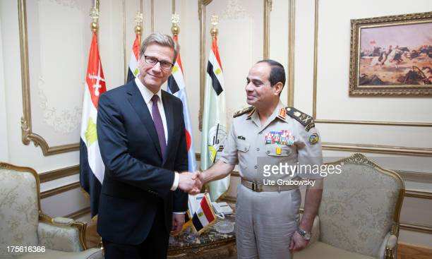 German Foreign Mnister Guido Westerwelle and Egyptian Defense Minister and Vice Prime Minister General Abdel Fattah alSisi shake hands on August 01...