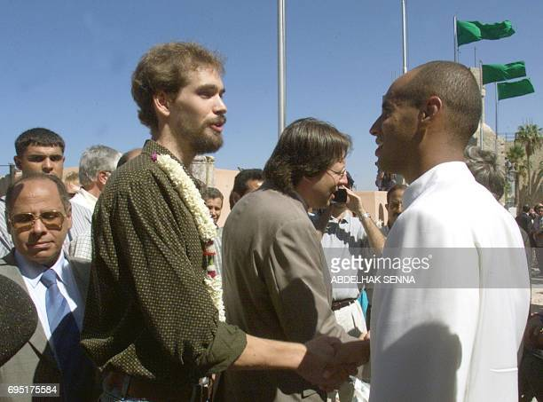German former hostage Marc Wallert shakes hands with Seif al-Islam , the son of Libyan leader Moammer Kadhafi and head of the Kadhafi Charitable...