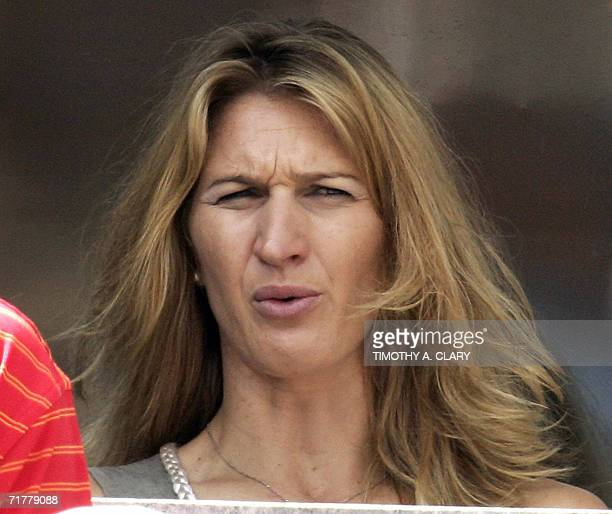 German former tennis star Steffi Graf, wife of US player Andre Agassi, grimaces during her husband's third round loss to Germany's Benjamin Becker at...